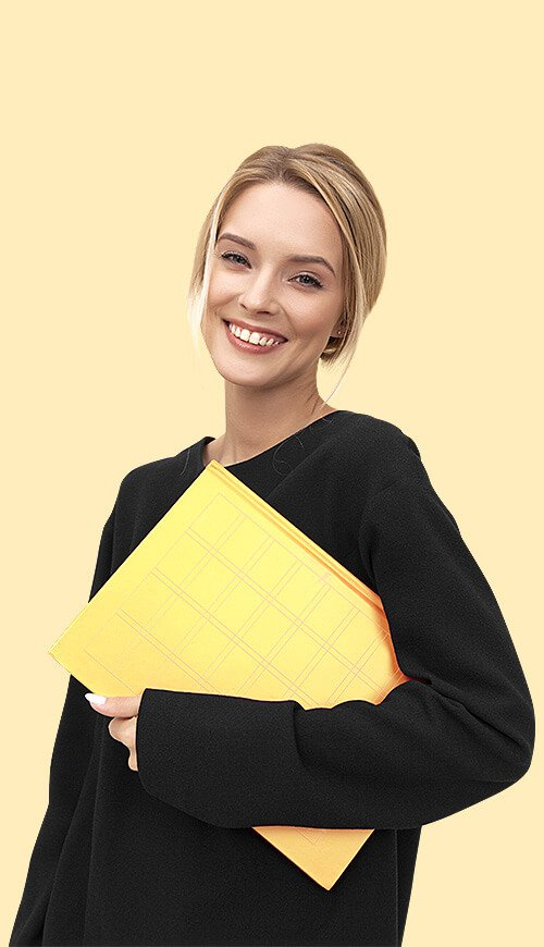 woman smiling holding a folder